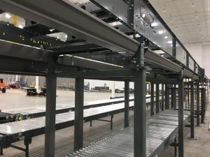 drip pan installed on package conveyor sortation system