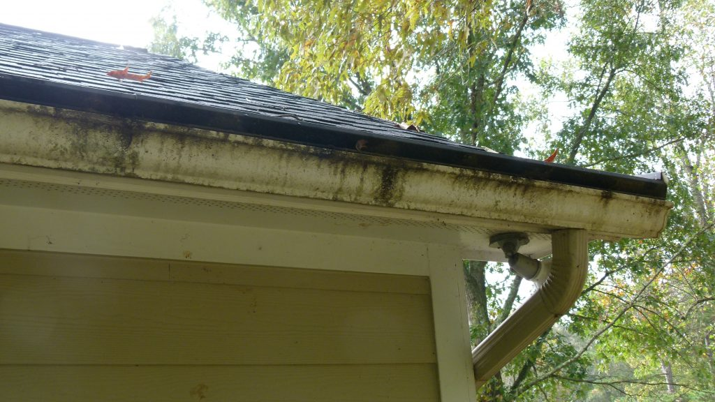 solid gutter cover with clogged opening